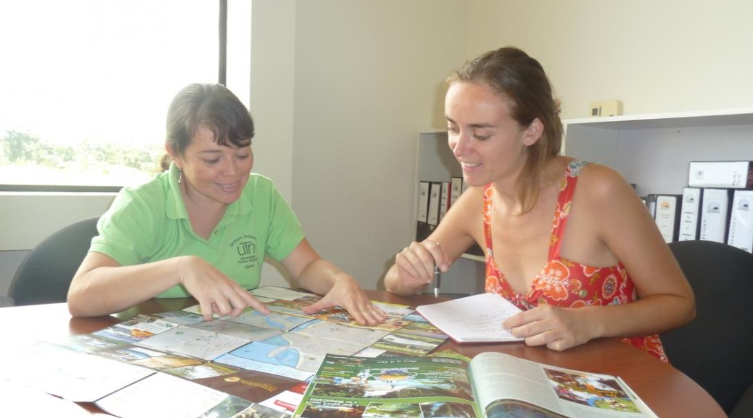 The Spanish teacher helps her student practice by getting her to read Spanish magazines in Costa Rica